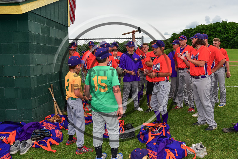Cortland Crush Head Coach Bill McConnell (6) introducing two of the First Pitch participants for a game against the Sherrill Silversmiths at the LaFayette Junior and Senior High School Field in LaFayette, New York on Saturday, June 9, 2018.