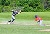 Cortland Crush Dylan Ketch (14) starts to slide under the Sherrill Silversmiths 3rd Baseman at the LaFayette Junior and Senior High School Field in LaFayette, New York on Saturday, June 9, 2018. Cortland won 12-6.