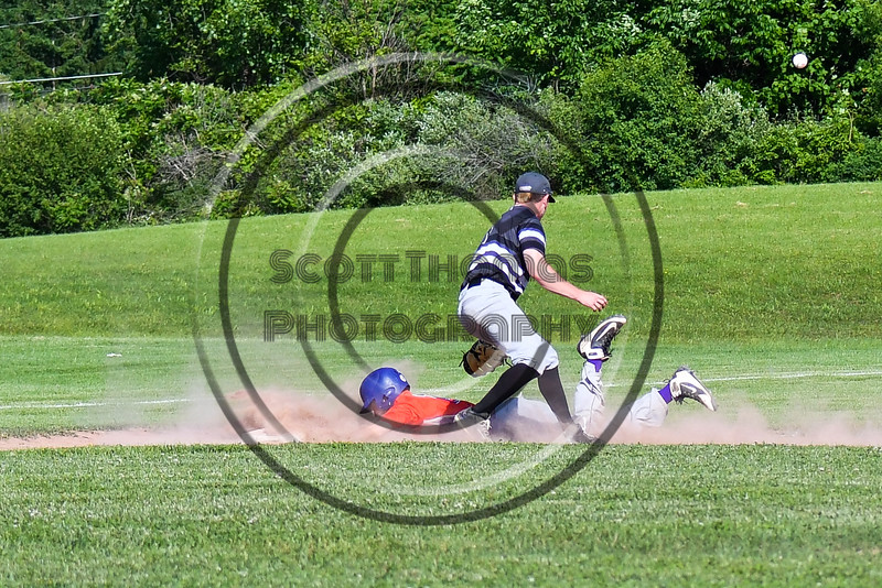 Cortland Crush Dylan Ketch (14) slides safely into 3rd Base against Sherrill Silversmiths 3rd Baseman at the LaFayette Junior and Senior High School Field in LaFayette, New York on Saturday, June 9, 2018. Cortland won 12-6.