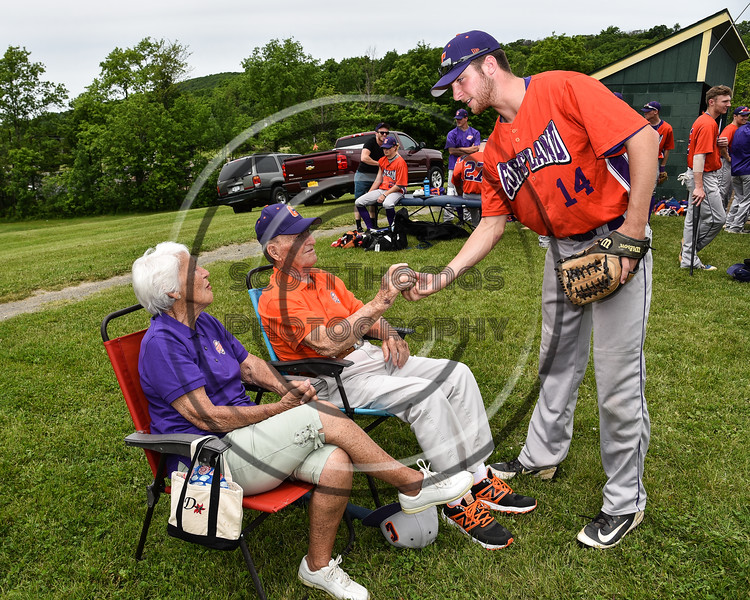 Cortland Crush Dylan Ketch (14) presents a baseball signed by the Crush players to the parents of Head Coach Bill McConnell (6), Dorothy and Bill, before a game against the Sherrill Silversmiths at the LaFayette Junior and Senior High School Field in LaFayette, New York on Saturday, June 9, 2018.