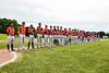 Cortland Crush stand along the 1st Base line for the National Anthem before playing the Sherrill Silversmiths at the LaFayette Junior and Senior High School Field in LaFayette, New York on Saturday, June 9, 2018.
