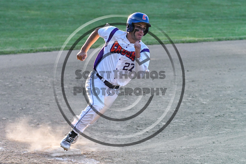 Cortland Crush Nick Palma (27) turns the corner at 3rd Base to score a run against the Onondaga Flames on Greg's Field at Beaudry Park in Cortland, New York on Friday, June 15, 2018. Onondaga won 8-7.
