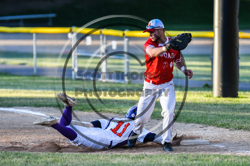 Cortland Crush Julio Creazzola (11) dives back to 1st Base against Onondaga Flames Corbin Paxton (8) on Greg's Field at Beaudry Park in Cortland, New York on Friday, June 15, 2018. Onondaga won 8-7.