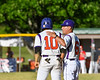 Cortland Crush Head Coach Bill McConnell (6) talks with Nelson Laviosa (10) at 3rd Base against the Onondaga Flames on Greg's Field at Beaudry Park in Cortland, New York on Friday, June 15, 2018. Onondaga won 8-7.