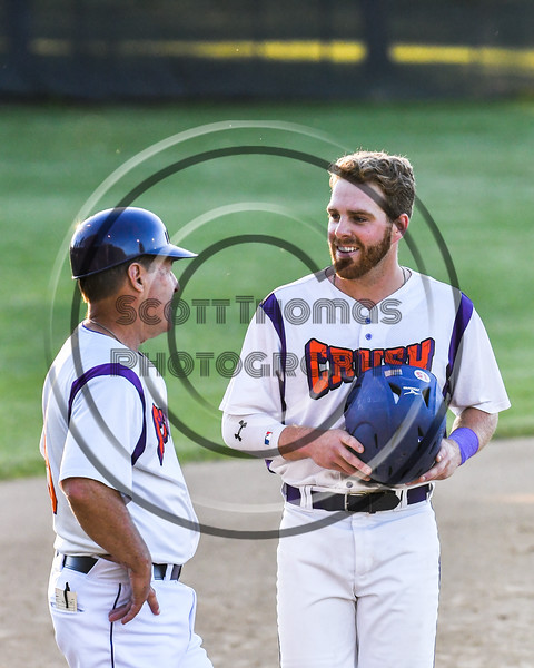 Cortland Crush Justin Valentino (15) talks with Head Coach Bill McConnell (6) during the game against the Onondaga Flames on Greg's Field at Beaudry Park in Cortland, New York on Friday, June 15, 2018. Onondaga won 8-7.