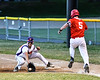 Cortland Crush Nick Palma (27) digs the ball out before  Onondaga Flames Bryan Hart (5) gets to 1st Base on Greg's Field at Beaudry Park in Cortland, New York on Friday, June 15, 2018. Onondaga won 8-7.