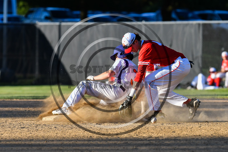 Cortland Crush Anthony Cieszko (3) slides innto 2nd Base past Onondaga Flames Jake Evans (4) and the loose ball on Greg's Field at Beaudry Park in Cortland, New York on Friday, June 15, 2018. Onondaga won 8-7.