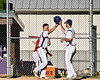 Cortland Crush Nick Palma (27) gets congratulations from a teammate after scoring a run against the Onondaga Flames on Greg's Field at Beaudry Park in Cortland, New York on Friday, June 15, 2018. Onondaga won 8-7.