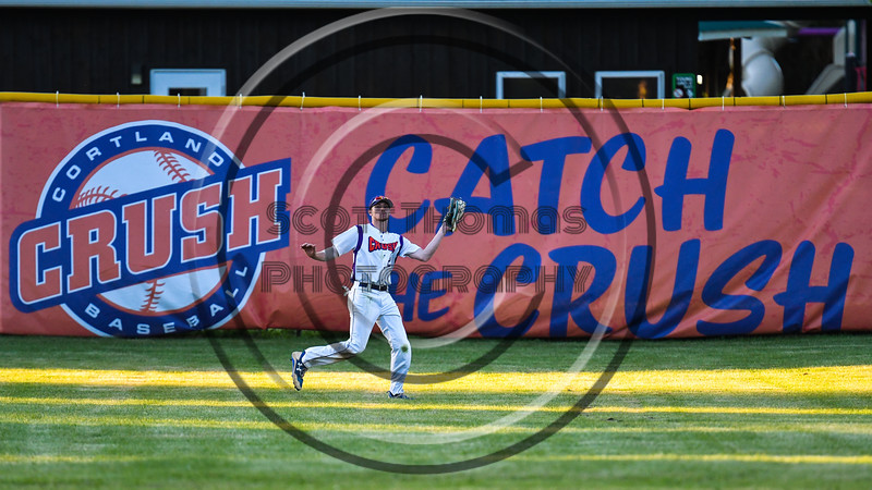 Cortland Crush Alex Flock (2) catches a fly ball for anout against the Onondaga Flames on Greg's Field at Beaudry Park in Cortland, New York on Friday, June 15, 2018. Onondaga won 8-7.