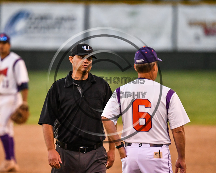 Cortland Crush Head Coach Bill McConnell (6) disputs a call by the 1st Base Umpire against the Onondaga Flames on Greg's Field at Beaudry Park in Cortland, New York on Friday, June 15, 2018. Onondaga won 8-7.