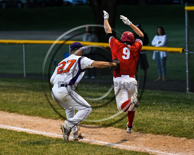 Cortland Crush Nick Palma (27) tags Onondaga Flames Michael Netzel (9) out on Greg's Field at Beaudry Park in Cortland, New York on Friday, June 15, 2018. Onondaga won 8-7.