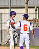 Cortland Crush Head Coach Bill McConnell (6) gives instructions to Alex Flock (2) before his at bat against the Onondaga Flames on Greg's Field at Beaudry Park in Cortland, New York on Friday, June 15, 2018. Onondaga won 8-7.