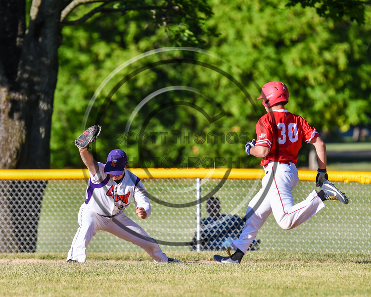 Cortland Crush Nick Palma (27) catches the ball for a force out at 1st Base against the Onondaga Flames on Greg's Field at Beaudry Park in Cortland, New York on Friday, June 15, 2018. Onondaga won 8-7.