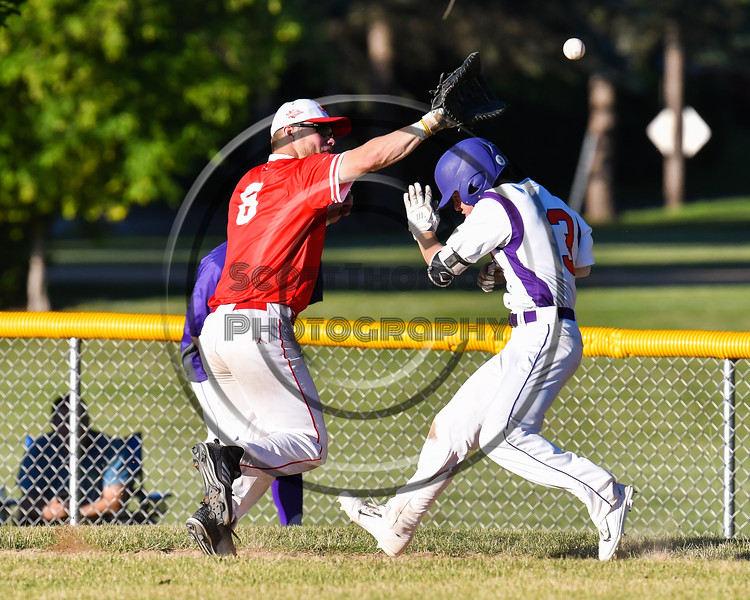 Cortland Crush Anthony Cieszko (3) ducts under the throw to Onondaga Flames Corbin Paxton (8) on Greg's Field at Beaudry Park in Cortland, New York on Friday, June 15, 2018. Onondaga won 8-7.
