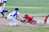 Cortland Crush Anthony Cieszko (3) tags Onondaga Flames Michael Netzel (9) out on Greg's Field at Beaudry Park in Cortland, New York on Friday, June 15, 2018. Onondaga won 8-7.