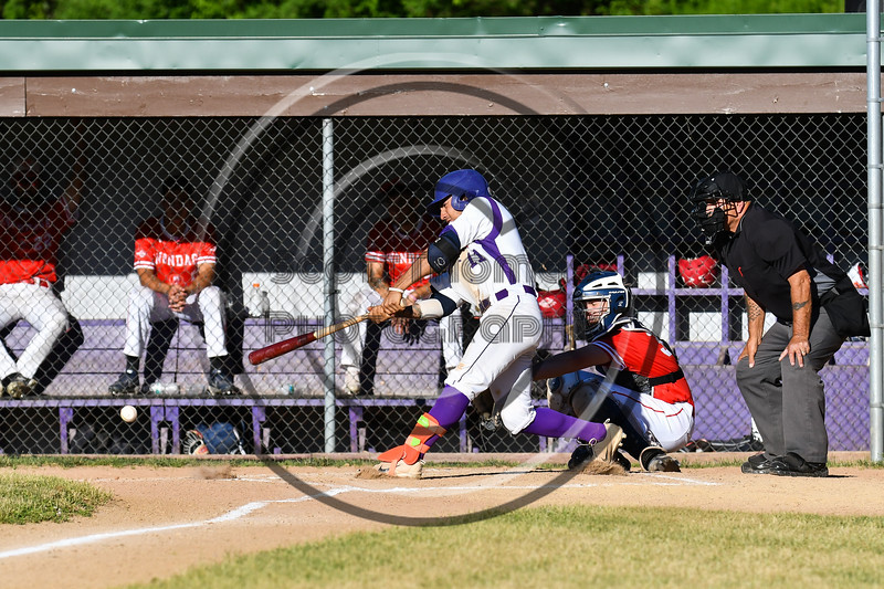 Cortland Crush Julio Creazzola (11) gets a hit against the Onondaga Flames on Greg's Field at Beaudry Park in Cortland, New York on Friday, June 15, 2018. Onondaga won 8-7.