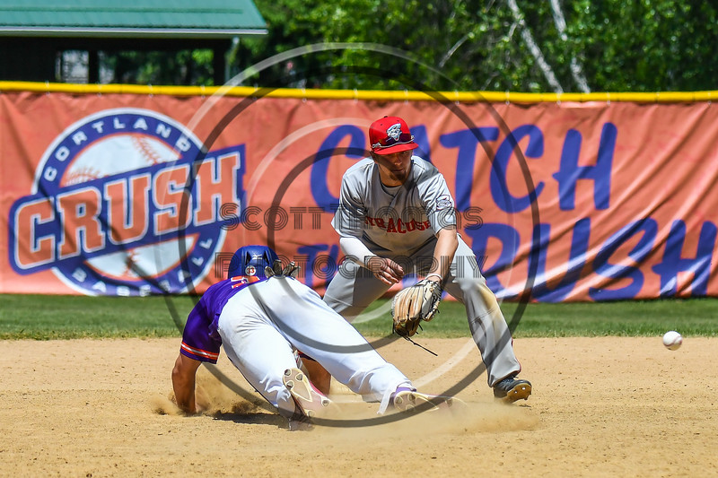 Cortland Crush Zach Kelley (33) dives back to 2nd Base before the ball agains the Syracuse Salt Cats on Greg's Field at Beaudry Park in Cortland, New York on Saturday, June 16, 2018. Cortland won 10-0.