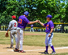 Cortland Crush Head Coach Bill McConnell (6) gives knuckles to Zach Kelley (33) after reaching 3rd Base against the Syracuse Salt Cats on Greg's Field at Beaudry Park in Cortland, New York on Saturday, June 16, 2018. Cortland won 10-0.