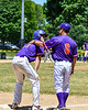 Cortland Crush Head Coach Bill McConnell (6) talks with Zach Kelley (33) at 3rd Base against the Syracuse Salt Cats on Greg's Field at Beaudry Park in Cortland, New York on Saturday, June 16, 2018. Cortland won 10-0.