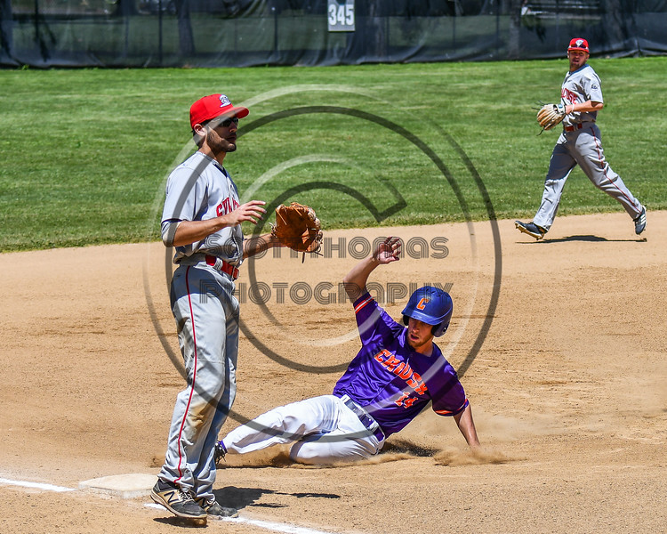 Cortland Crush Dylan Ketch (14) slides into 3rd Base against the Syracuse Salt Cats on Greg's Field at Beaudry Park in Cortland, New York on Saturday, June 16, 2018. Cortland won 10-0.