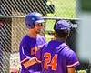 Cortland Crush Shane Epps (24) congratulates Dylan Ketch (14) for scoring a run against the Syracuse Salt Cats on Greg's Field at Beaudry Park in Cortland, New York on Saturday, June 16, 2018. Cortland won 10-0.