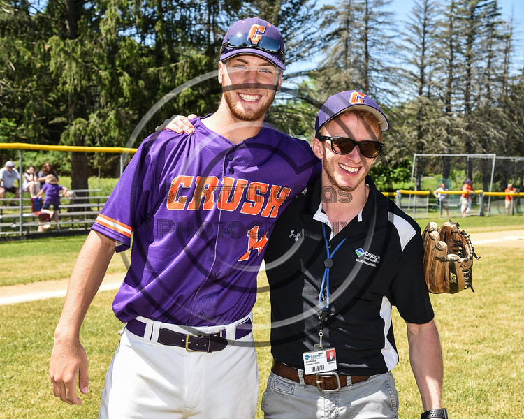 Cortland Crush Athletic Trainer Anthony Spinelli and Dylan Ketch (14) on Greg's Field at Beaudry Park in Cortland, New York on Saturday, June 16, 2018.