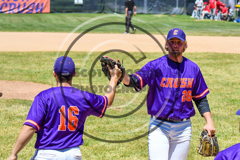 Cortland Crush Alex Larson (26) gets congratulated by Alex Babcock (16) after getting the Syracuse Salt Cats out on Greg's Field at Beaudry Park in Cortland, New York on Saturday, June 16, 2018. Cortland won 10-0.
