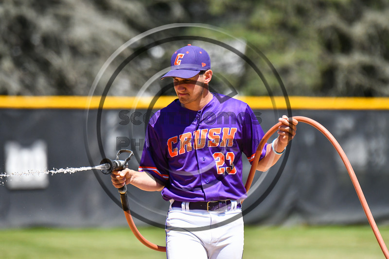 Cortland Crush Maxwell Tannebaum (23) trying to water down the infield on Greg's Field at Beaudry Park in Cortland, New York on Saturday, June 16, 2018.