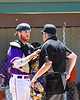 Cortland Crush Catcher Justin Valentino (15) has a word with the Home Plate Umpire before the start of an inning against the Syracuse Salt Cats on Greg's Field at Beaudry Park in Cortland, New York on Saturday, June 16, 2018. Cortland won 10-0.