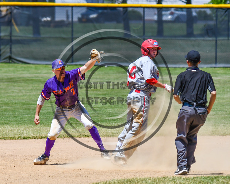 Cortland Crush Tyler McKeon (7) showing the umpire the ball to prove he forced out the Syracuse Salt Cats runner on Greg's Field at Beaudry Park in Cortland, New York on Saturday, June 16, 2018. Cortland won 10-0.