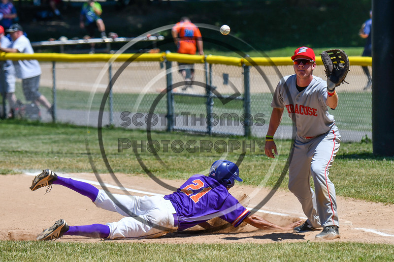 Cortland Crush Joe Palmo (21) slides back to 1s Base against the Syracuse Salt Cats on Greg's Field at Beaudry Park in Cortland, New York on Saturday, June 16, 2018. Cortland won 10-0.