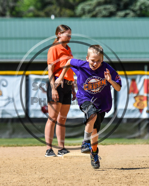 Young Cortland Crush fan running the bases during a break in the action of a NYCBL game on Greg's Field at Beaudry Park in Cortland, New York on Saturday, June 16, 2018.