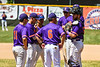 Cortland Crush Head Coach Bill McConnell (6) hosts a meeting on the mound during a timeout against the Syracuse Salt Cats on Greg's Field at Beaudry Park in Cortland, New York on Saturday, June 16, 2018. Syracuse won 8-6.