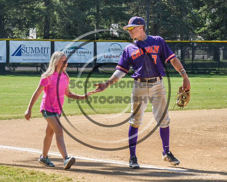 Cortland Crush Tyler McKeon (7) congratulates the winner of the race on Greg's Field at Beaudry Park in Cortland, New York on Saturday, June 16, 2018.