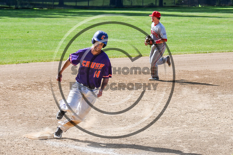 Cortland Crush Dylan Ketch (14) rounding 3rd Base to score against the Syracuse Salt Cats on Greg's Field at Beaudry Park in Cortland, New York on Saturday, June 16, 2018. Syracuse won 8-6.