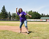 Ames Linen Service representative throws out the First Pitch before a Cortland Crush game on Greg's Field at Beaudry Park in Cortland, New York on Saturday, June 16, 2018.