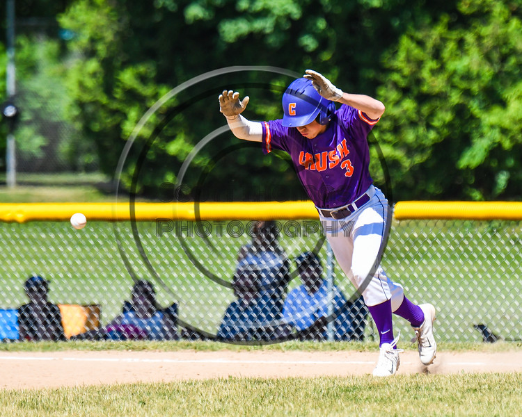 Cortland Crush Anthony Cieszko (3) avoids the ball while running the bases against the Syracuse Salt Cats on Greg's Field at Beaudry Park in Cortland, New York on Saturday, June 16, 2018. Syracuse won 8-6.