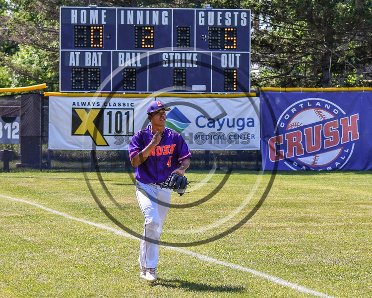 Cortland Crush Justin Pacheco (4) jogs in from the Bull Pen to take over pitching duites against the Syracuse Salt Cats on Greg's Field at Beaudry Park in Cortland, New York on Saturday, June 16, 2018. Syracuse won 8-6.