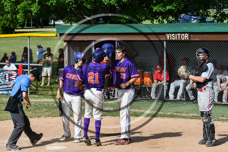 Cortland Crush players Nick Palma (27) and Zach Kelley (33) congratulate Joe Palmo (21) on his Home Run against the Syracuse Salt Cats on Greg's Field at Beaudry Park in Cortland, New York on Saturday, June 16, 2018. Syracuse won 8-6.