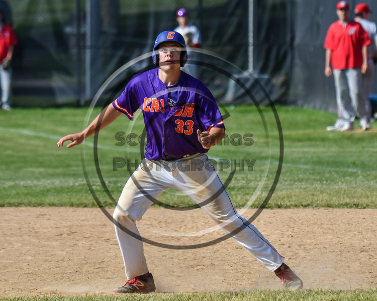 Cortland Crush Zach Kelley (33) watching the ball while on base against the Syracuse Salt Cats on Greg's Field at Beaudry Park in Cortland, New York on Saturday, June 16, 2018. Syracuse won 8-6.