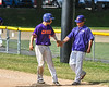 Cortland Crush Joe Palmo (21) is congratulated by Assistant and First Base Coach Connor Griffin (28) for reaching 1st Base against the Syracuse Salt Cats on Greg's Field at Beaudry Park in Cortland, New York on Saturday, June 16, 2018. Syracuse won 8-6.