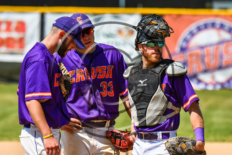 Cortland Crush Michael Perreault (8), Zach Kelley (33) and Justin Valentino (15) in a conference at the mound duirng a timeut against the Syracuse Salt Cats on Greg's Field at Beaudry Park in Cortland, New York on Saturday, June 16, 2018. Syracuse won 8-6.