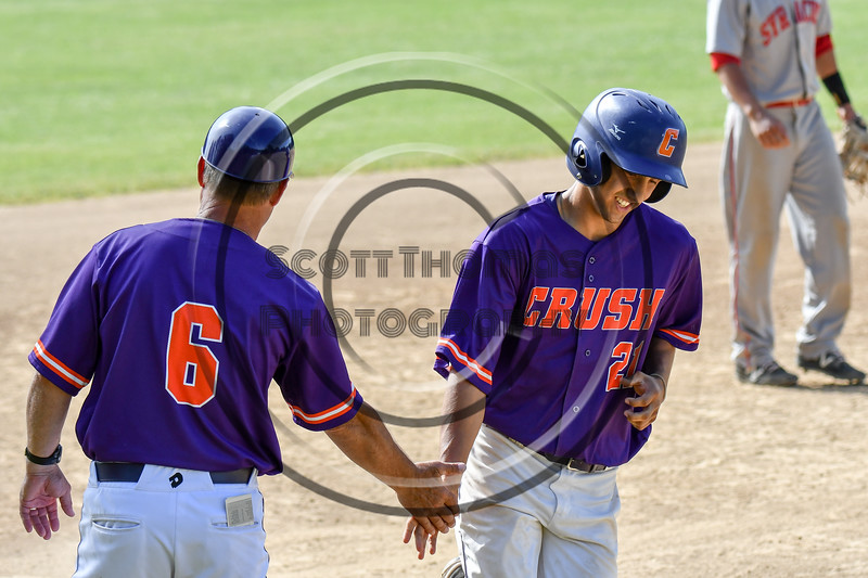 Cortland Crush Head Coach Bill McConnell (6) congratulates Joe Palmo (21) on his Home Run against the Syracuse Salt Cats on Greg's Field at Beaudry Park in Cortland, New York on Saturday, June 16, 2018. Syracuse won 8-6.