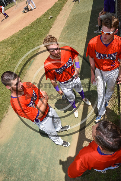 Cortland Crush Head Coach Bill McConnell (6) talking with Dylan Ketch (14), Justin Valentino (15) and Alex Flock (2) before playing the Sherrill Silversmiths on Greg's Field at Beaudry Park in Cortland, New York on Sunday, June 17, 2018.