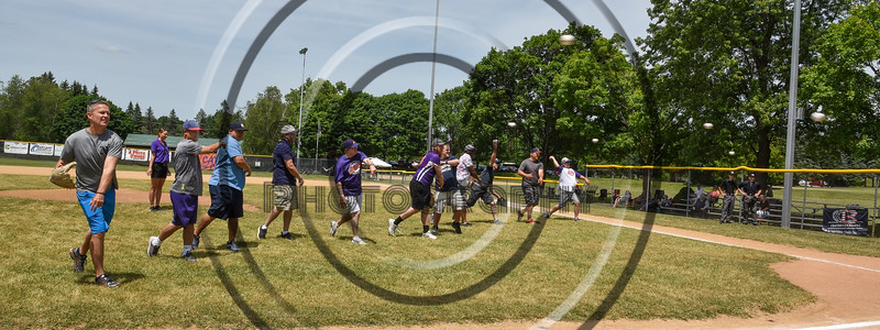 Fathers of Cortland Crush players throw out the First Pitch on Father's Day before a NYCBL baseball game on Greg's Field at Beaudry Park in Cortland, New York on Sunday, June 17, 2018.