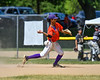 Cortland Crush Iset Maldonado (1) about to throw out the Sherrill Silversmiths runner at 1st Base on Greg's Field at Beaudry Park in Cortland, New York on Sunday, June 17, 2018. Cortland won 8-6.