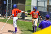 Cortland Crush Nelson Laviosa (10) gets congratulated by Tyler McKeon (7) for scoring a run against the Sherrill Silversmiths on Greg's Field at Beaudry Park in Cortland, New York on Sunday, June 17, 2018. Cortland won 8-6.