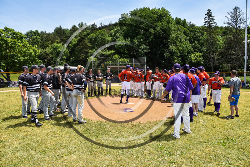 Cortland Crush Head Coach Bill McConnell (6) addresses his players and the Sherrill Silversmiths players on Father's Day on Greg's Field at Beaudry Park in Cortland, New York on Sunday, June 17, 2018.