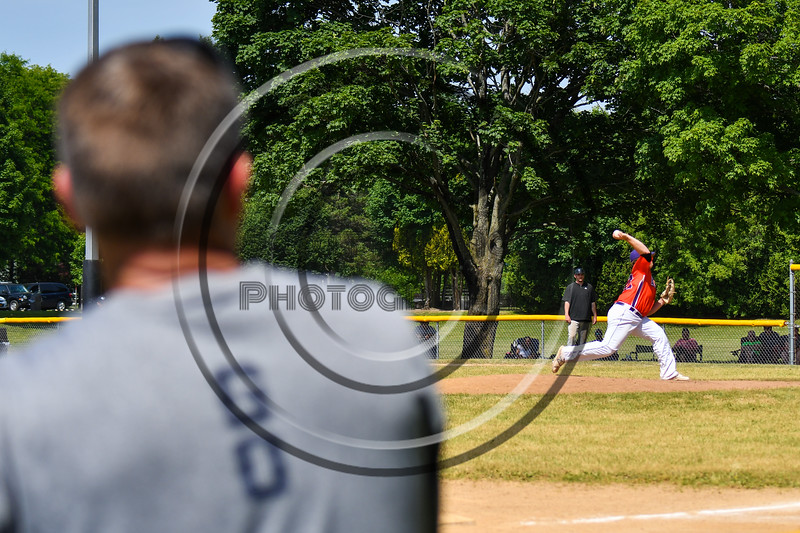 Cortland Crush Michael Doherty (32) pitches against the Sherrill Silversmiths as his father watches on Greg's Field at Beaudry Park in Cortland, New York on Sunday, June 17, 2018. Cortland won 8-6.