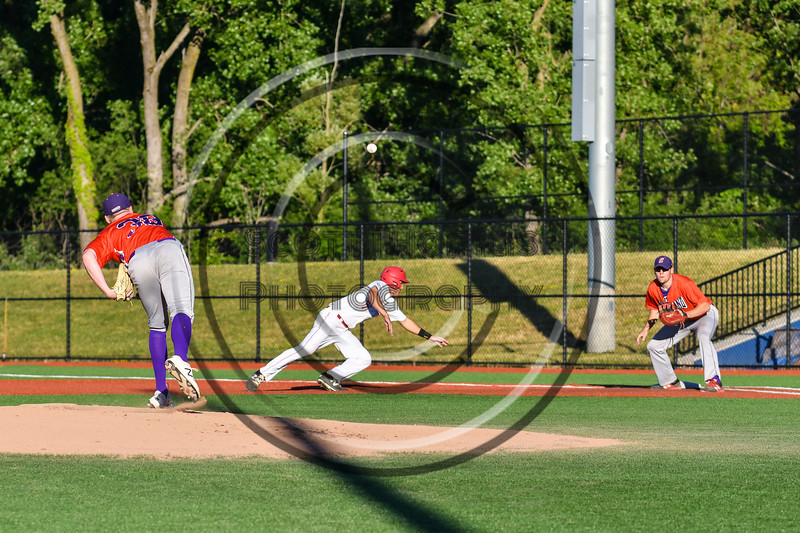Cortland Crush Brian Wojichowski (38) throwing the ball to 1st Base to keep the Syracuse Salt Cats base runner honest at OCC Turf Field in Syracuse, New York on Thursday, June 21, 2018. Syracuse won 6-2.